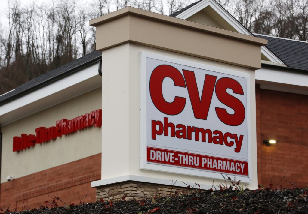 Drugstore and pharmacy benefits manager CVS did raise its annual profit forecast and rose 4.2 percent to $68.17 a share, with increased prescriptions sales a factor.