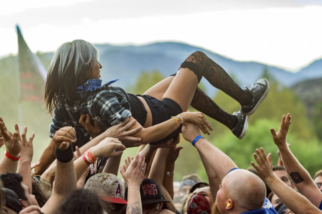 Crowd-surfing, as seen at the 2015 Knotfest USA in San Bernardino, Calif., often entails groping.
