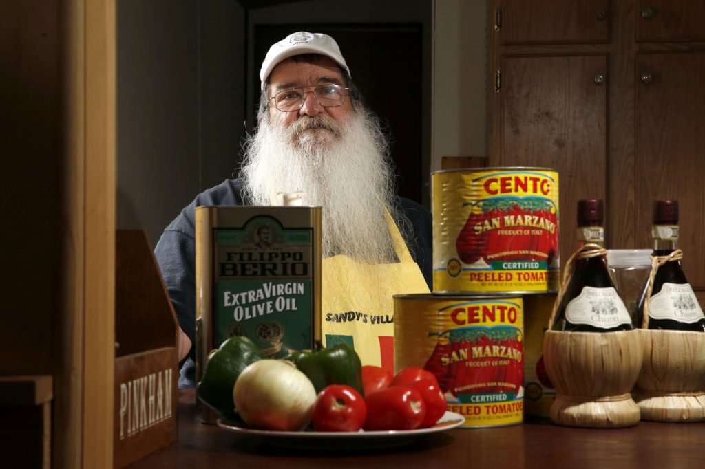 "Steve DeSanctis, surrounded by some of the ingredients for Dynamite sandwiches. ""This is not fast-food Italian. My sauce cooks for at least six-and-a-half hours,"" says DeSanctis, whose grandfather is credited with serving the first Dynamites in Madison."