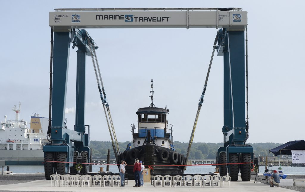 Portland Shipyard and Portland Yacht Services initiated service of this 330-metric-ton Marine Travelift in a ceremony Tuesday on Portland's western waterfront. The lift, which hoists large boats from the water and moves them to workshops on land, is crucial to a plan to develop a boat- and ship-repair complex at a vacant rail yard. The crane is the latest development for the Canal Landing marine complex at 400 West Commercial St.