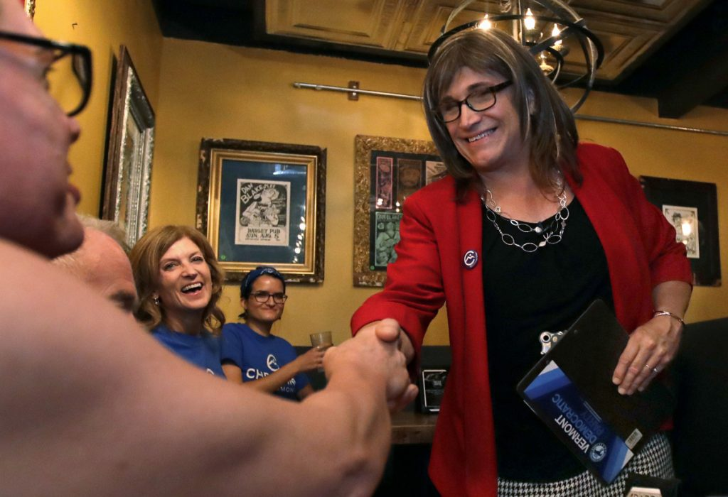 Christine Hallquist shakes hands with supporters Tuesday after becoming the first transgender candidate to win a major political party's nomination for governor.