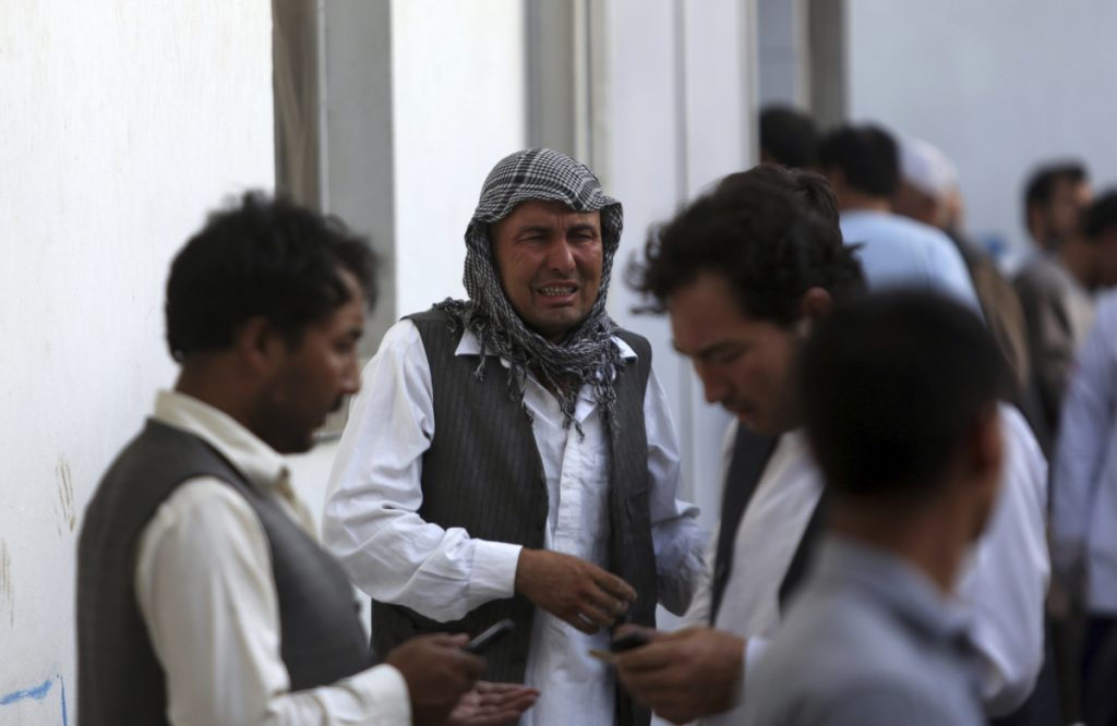Afghans mourn a victim of a deadly suicide bombing that targeted a training class in a private building in the Shiite neighbourhood of Dasht-i Barcha, in western Kabul on Wednesday.