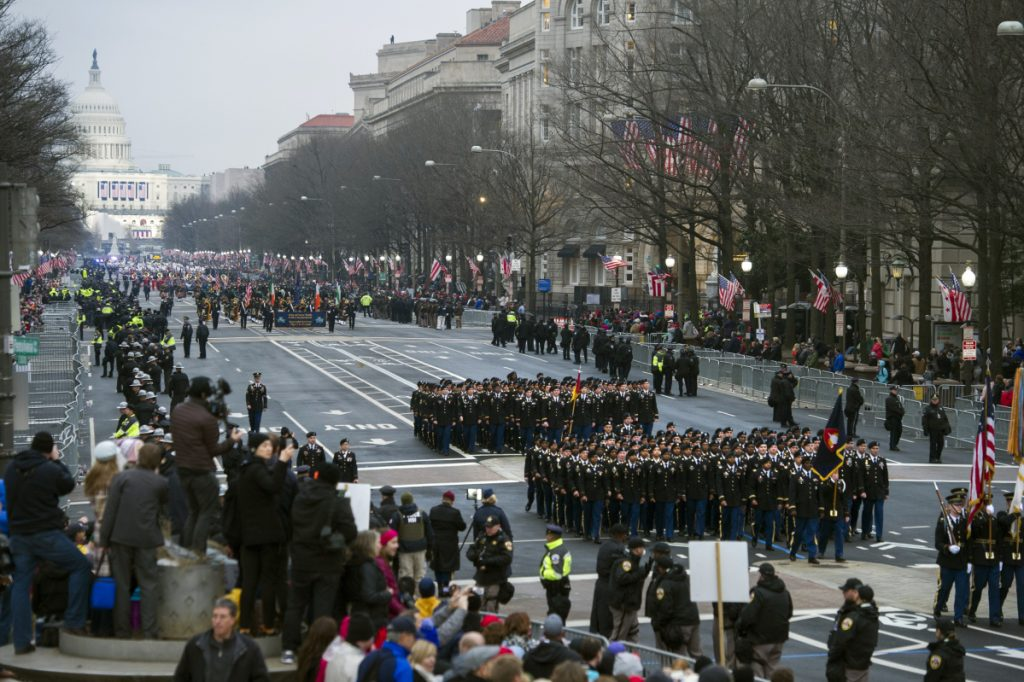 Military units participate in Trump's inaugural parade in 2017. The military parade he requested has been postponed.
