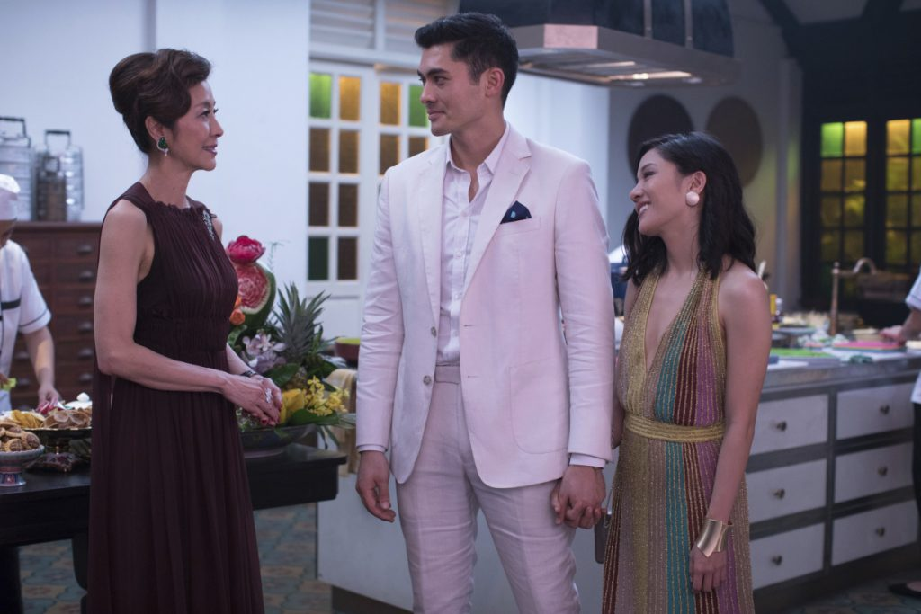 "Michelle Yeoh, from left, Henry Golding and Constance Wu in a scene from the film ""Crazy Rich Asians."""