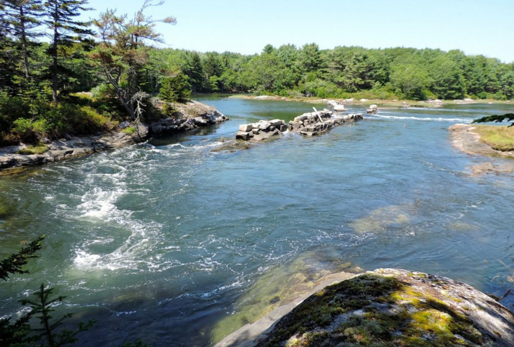 An old granite dam in Phippsburg separates the Morse River on the left and Spirit Pond on the right.