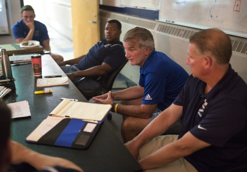Jack Cosgrove, second from right, retained most of the coaching staff from last year's Colby team, including wide receivers coach Tom Dexter, right, and defensive coordinator Sean Conerly, second from left. Former Colby player Mark Snyder, left, is now the running backs coach after graduating in the spring.