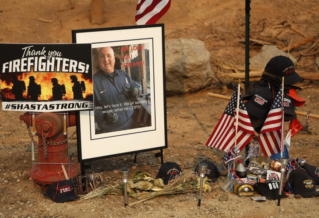 A memorial honors Jeremy Stoke of the Redding Fire Department in Redding, Calif. Stoke, 37, died July 26 when he was enveloped in seconds by a fire tornado with a base the size of three football fields and winds up to 165 mph.