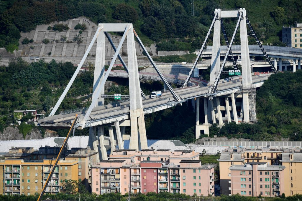 A view of the collapsed Morandi highway bridge in Genoa, Italy, on Sunday. The unofficial death toll in Tuesday's collapse rose to 43 on Saturday.