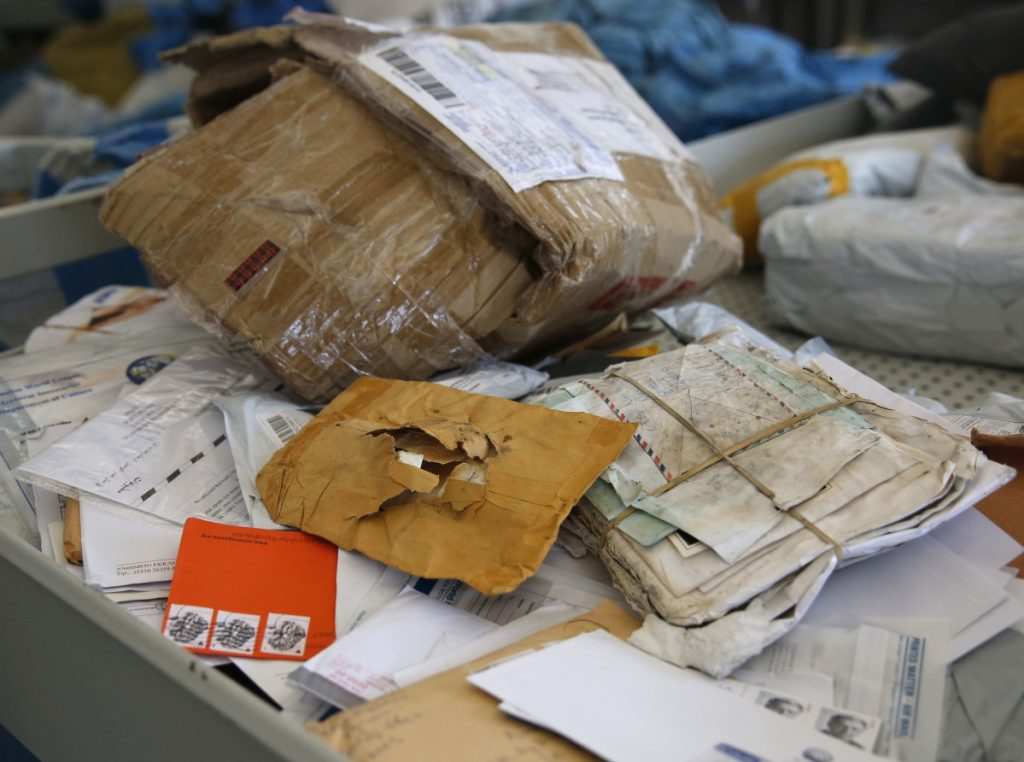 "Some of the years-old mail that Palestinians are working to sort. Israeli officials say the one-time release of 10.5 tons of mail was a ""gesture."""