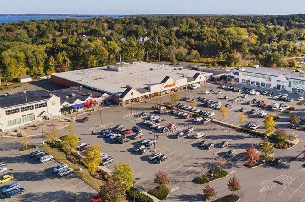 The Falmouth Shopping Center on Route 1 was sold this spring for $21 million. At least one tenant says she has high hopes for its future.