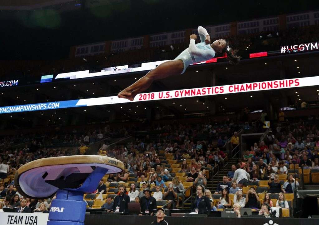 Simone Biles warms up on the vault at the U.S. Gymnastics Championships at Boston's TD Garden on Sunday. (AP Photo/Elise Amendola)