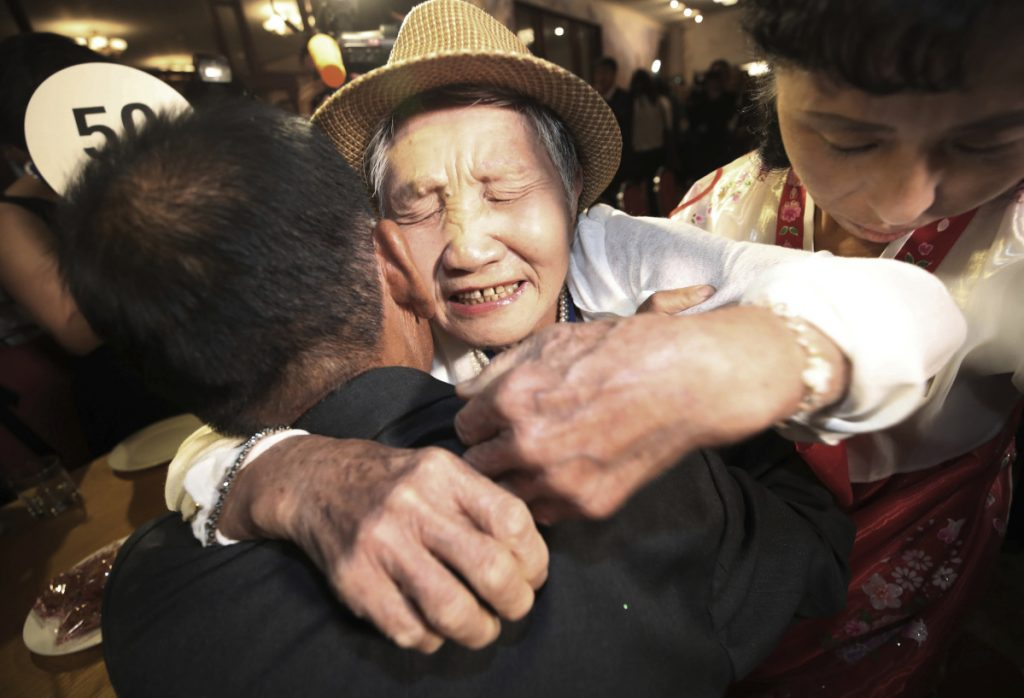 South Korean Lee Keum-seom, 92, hugs her North Korean son Ri Sang Chol, 71, during the Separated Family Reunion Meeting at the Diamond Mountain resort in North Korea.
