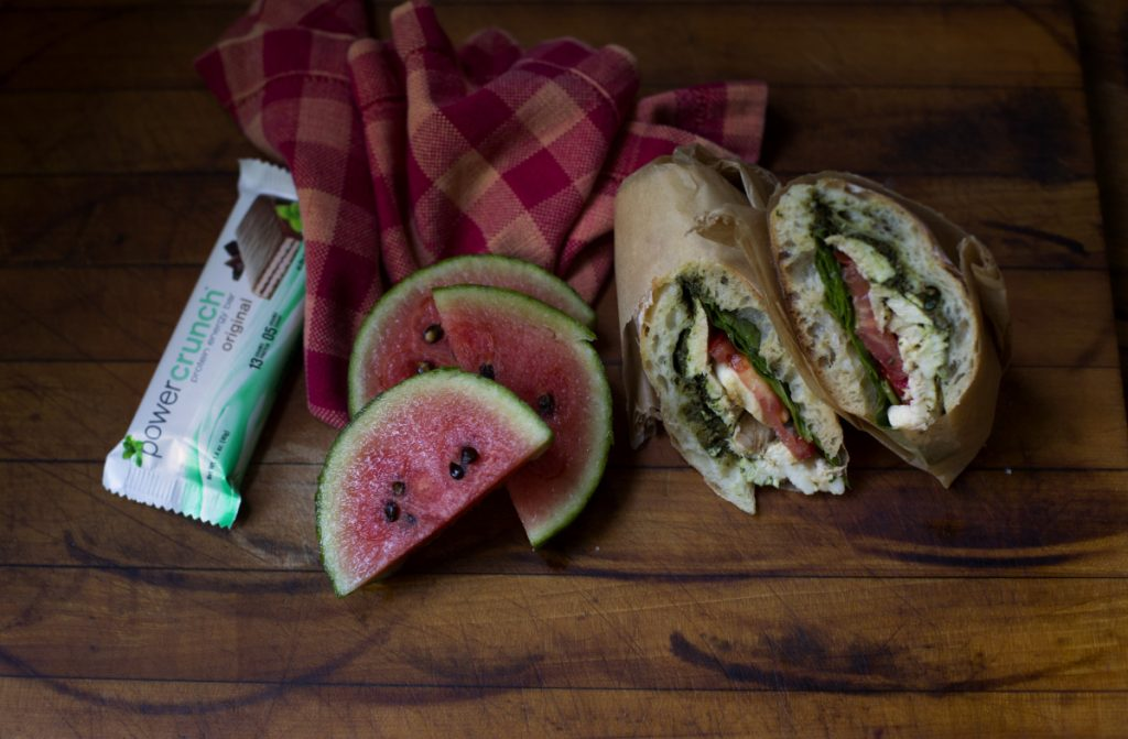 A substantial sandwich, protein bar and fruit comprise a lunch that can carry a hungry teen through a busy 12-hour day of classes, activities and sports.