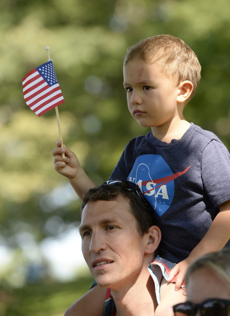 Chad Kalocinski, Navy, with his son Patrick, 4, on his shoulders after completing the Stone Coast Challenge on Thursday.