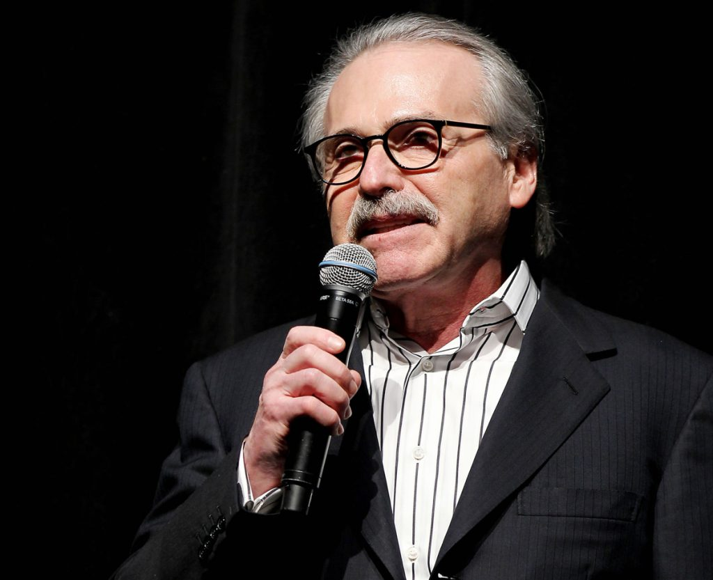 In this Jan. 31, 2014 photo, David Pecker, Chairman and CEO of American Media, addresses those attending the Shape & Men's Fitness Super Bowl Party in New York. The Aug. 21, 2018 plea deal reached by Donald Trump's former attorney Michael Cohen has laid bare a relationship between the president and Pecker, whose company publishes the National Enquirer. Besides detailing tabloid's involvement in payoffs to porn star Stormy Daniels and Playboy Playmate Karen McDougal to keep quiet about alleged affairs with Trump, court papers showed how David Pecker, a longtime friend of the president, offered to help Trump stave off negative stories during the 2016 campaign.