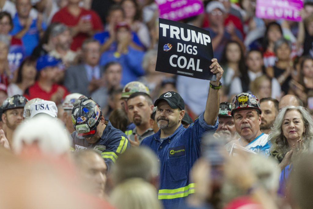Coal miners wait for President Trump to take the stage at a rally in Charleston last week. The administration's plan to ease carbon dioxide limits would also allow efficiency upgrades to old plants without requiring emissions controls.