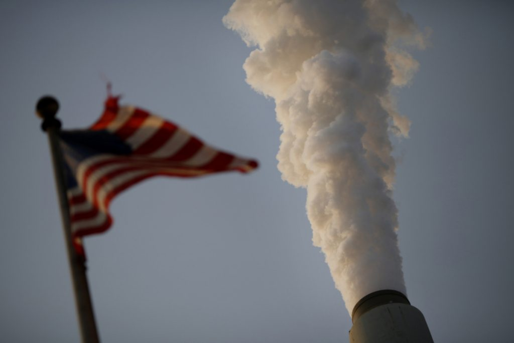 A U.S. flag flies at a coal-fired power plant in West Virginia, one of President Trump's most loyal states.