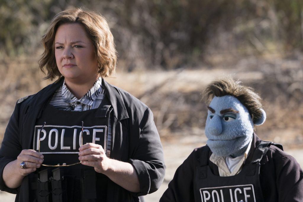 "Melissa McCarthy in a scene from ""The Happytime Murders."" Weekend audiences shunned this puppet caper and the robot-dog fantasy ""A.X.L."" and mobbed ""Asians."""