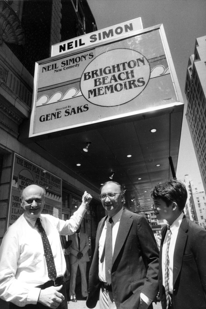 In this 1983 photo, Mayor Ed Koch, left, points to the new marquee which renames the Alvin Theater the Neil Simon Theatre as he is joined by playwright Neil Simon, center, and actor Matthew Broderick in New York.