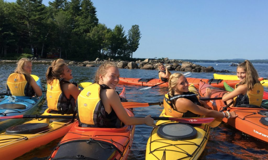 Members of the 2017 Windham girls' soccer team kayaked around Frye Island and rafted together to provide enough stabilty for teammates to walk across the bows of their watercraft.