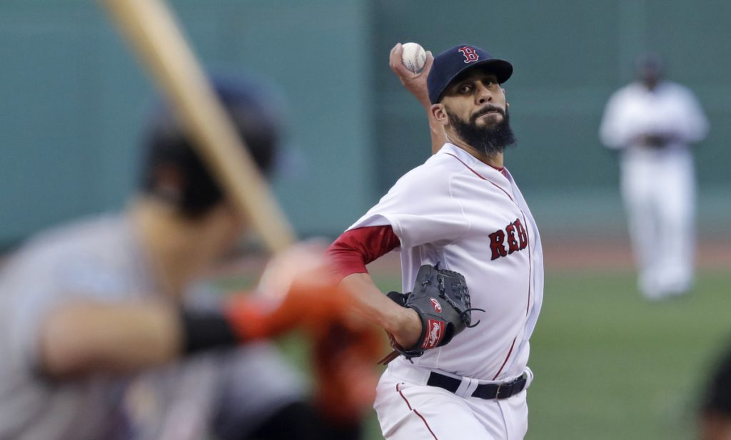 Boston starting pitcher David Price delivers during the first inning against Miami Marlins at Fenway Park on Wednesday. Price left the game after three innings with a bruised wrist.