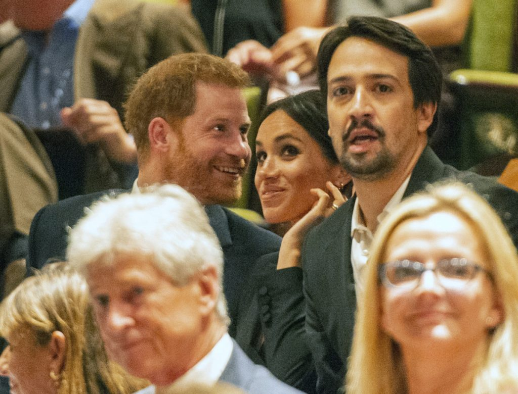 "Prince Harry and his wife, Meghan, are seated next to Lin-Manuel Miranda at a gala performance of ""Hamilton"" in London on Wednesday."