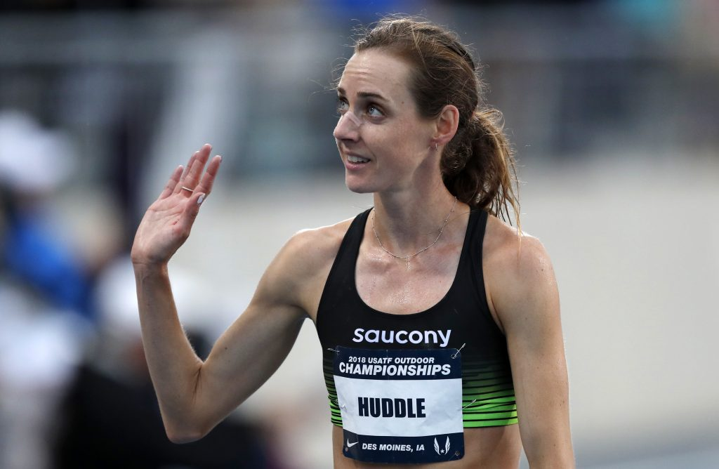 Molly Huddle waves to a fan after winning the women's 10,000 meters at the U.S. Championships athletics meet Thursday, June 21, 2018, in Des Moines, Iowa. (AP Photo/Charlie Neibergall)