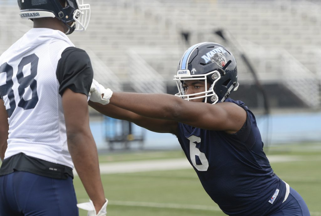 Sterling Sheffield runs drills during the first day of training camp for UMaine football Wednesday in Orono.