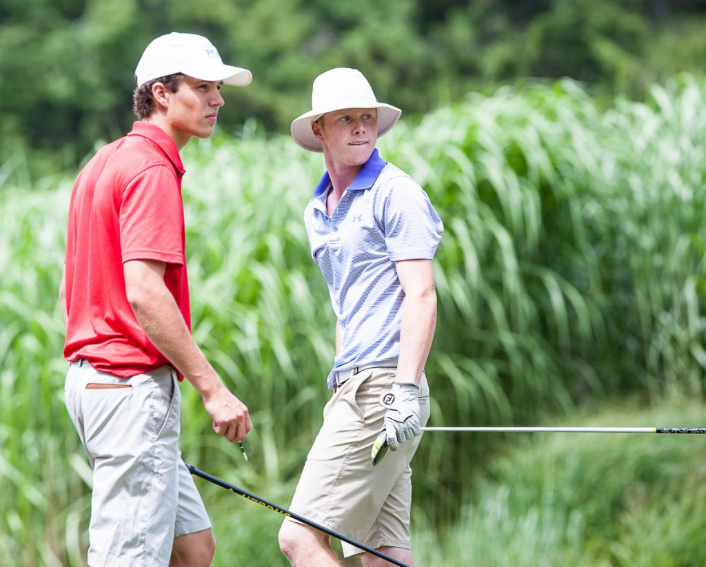 Mitchell Tarrio right watches his tee shot bounce on the fairway as Ryan Collins gets ready to tee up his ball at Brunswick Golf Club on Wednesday during the final round of the Maine Junior Championship.