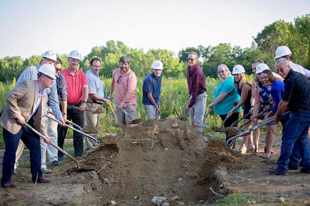 Monmouth area officials help break ground on the town's new middle-elementary school on the evening of July 31. The school, which is expected to open in January 2020, is being mostly funded by the state.