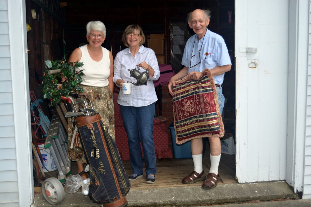 Farmington Historical Society treasurer Jane Woodman, left, with past-president Al McDaniel collecting items with donor Sylvia Yeaton at the Octagon House.