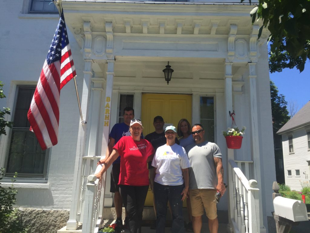 Wells Fargo employees from around Maine gather July 19 on the front steps of the Betsy Ann Rose House of Hope, in Augusta, where they spent the day cleaning up the third floor of the home, removing debris and building baseboards for a new bathroom, to help create additional living space so the shelter can serve more veterans and help them transition to permanent, independent housing. In front from left are Katy Wood, Wells Fargo community banking; Martha St. Pierre, Betsy Ann Rose House of Hope executive director; and Michael Sargent, Wells Fargo adviser. In back, from left, are Rob Small, Wells Fargo middle market banking; Ben Smith, Wells Fargo adviser; and Terry Simms, Wells Fargo adviser.