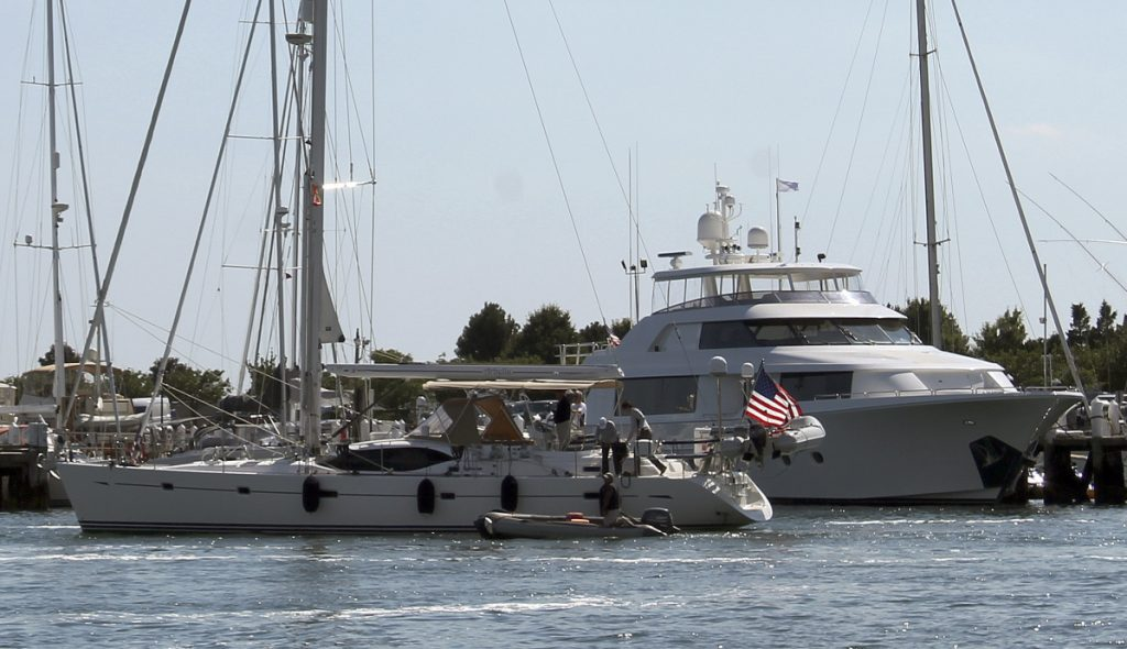 Boats sit docked July 12 in the Newport Shipyard in Newport, R.I. American boat makers are getting pummeled on multiple fronts by tariffs and stand to be among the industries hardest-hit in an escalating trade war.