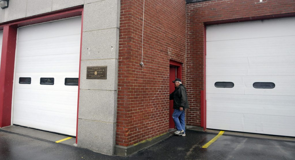 Winthrop Fire Dept. Deputy Chief Dave Currie enters the old fire station April 12, 2016. A Winthrop man has bid $160,100 for the Main Street property, which is valued at $272,900.