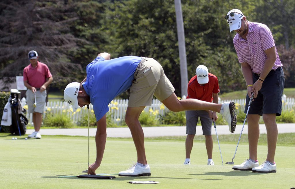 Golfers work on their putting during a Pro-Am event Monday at the Augusta Country Club in advance of the Charlie's Maine Open that starts Tuesday.