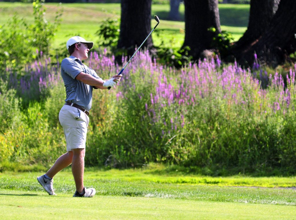 Staff photo by Joe Phelan   Jack Wyman hits a shot from the third fairway during the opening round of the Charlie's Maine Open on Tuesday at the Augusta Country Club in Manchester.