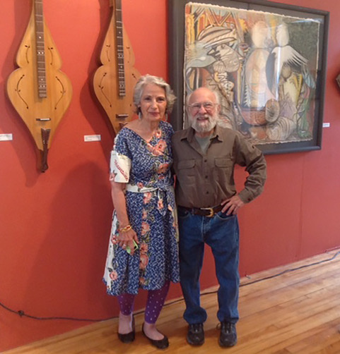 "Exhibiting artist Joseph Ascrizzi, at right, of Freedom, is shown with Elaine Pew, organizer of an exhibit of his work at the Maine Art Gallery Wiscasset. Ascrizzi will participate in ""A Conversation with the Artist"" at 6:30 p.m. Thursday, Aug. 16, in the gallery."