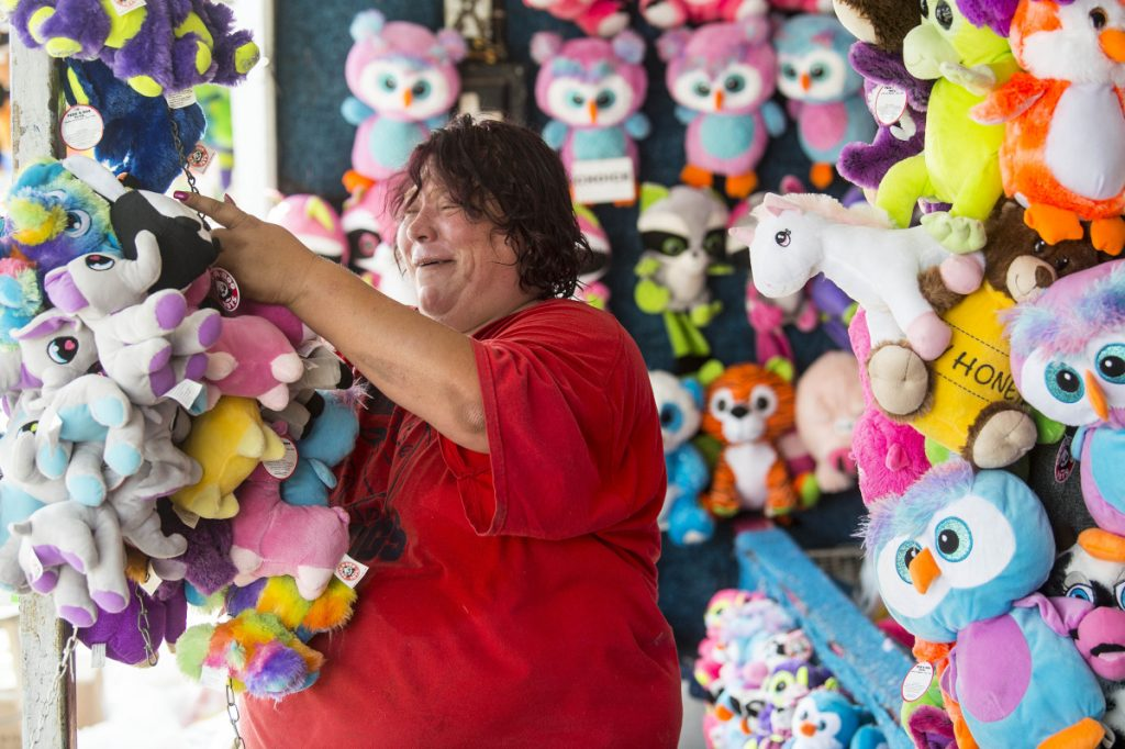 Kim Blanchard prepares her carnival game, Dakota's Root N' Toot-N Cork Gun Game, at the Skowhegan Fair Grounds for the 200th annual Skowhegan State Fair on Wednesday.