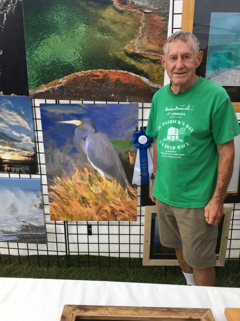 Walter Mularz with his award-winning photograph in the 2-D fine art category.