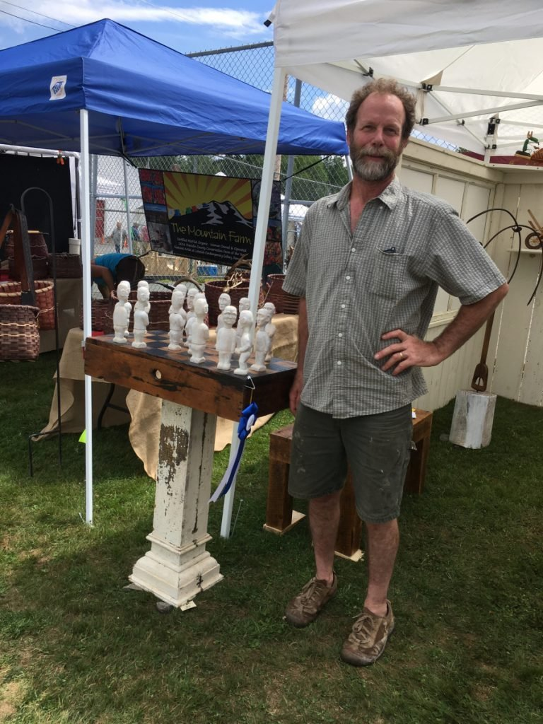 Rick Osterhout with his award-winning sculpture in the 3-D fine craft category.