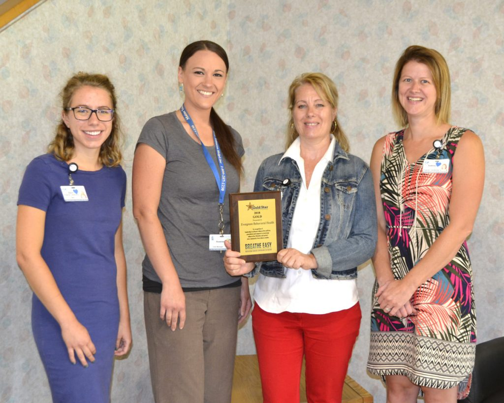 Evergreen Behavioral Services, based in Farmington, was recognized for meeting the gold award level for efforts to implement policies, procedures and treatment strategies to prohibit smoke and tobacco use on campus and address client tobacco use. From left are Ellen Thorne, HCC program and planning coordinator; Suzanna Brennan, EBS tobacco treatment specialist; Dalene Sinskie, EBS executive director; and Andrea Richards, HCC lead program and planning coordinator.