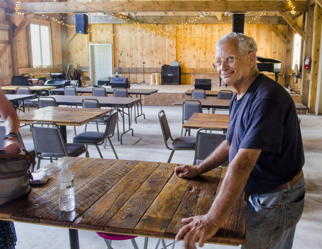 "Bob Bittar talks about plans for music in his barn Thursday, Aug. 9, in Readfield. Bittar lacks a town permit to operate a nonprofit or a commercial facility, so he's holding free concerts there for now; but he envisions the barn as a ""true performance center."""