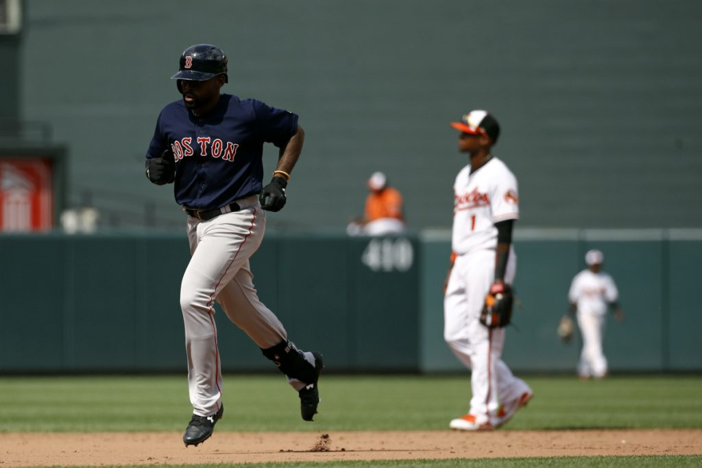 Boston Red Sox outfielder Jackie Bradley Jr., left, rounds the bases on a solo home run in the ninth inning of the first game of a doubleheader against the Baltimore Orioles on Saturday in Baltimore.