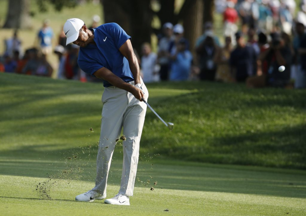 Tiger Woods hits to the 18th green during the third round of the PGA Championship on Saturday in St. Louis.