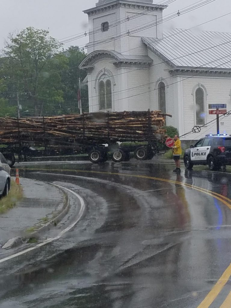 Two of the three lanes of traffic on Island Avenue in Skowhegan were closed Tuesday afternoon after a logging truck got caught in some wires.