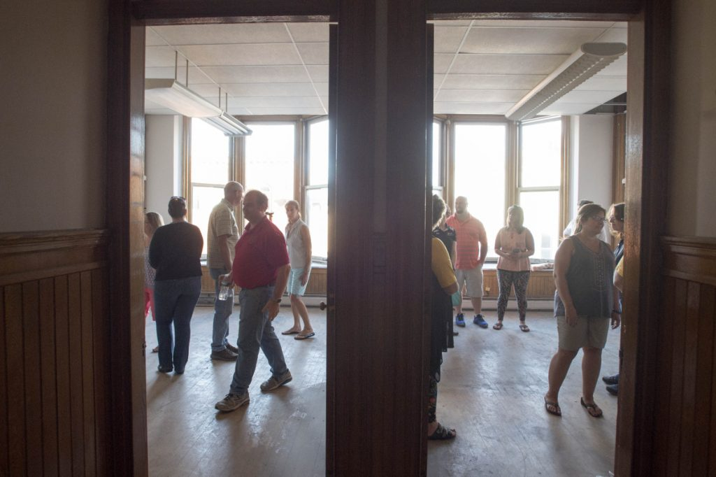 People tour the second floor of the new Cornville Charter School on Water Street in Skowhegan on Aug. 23, 2017.