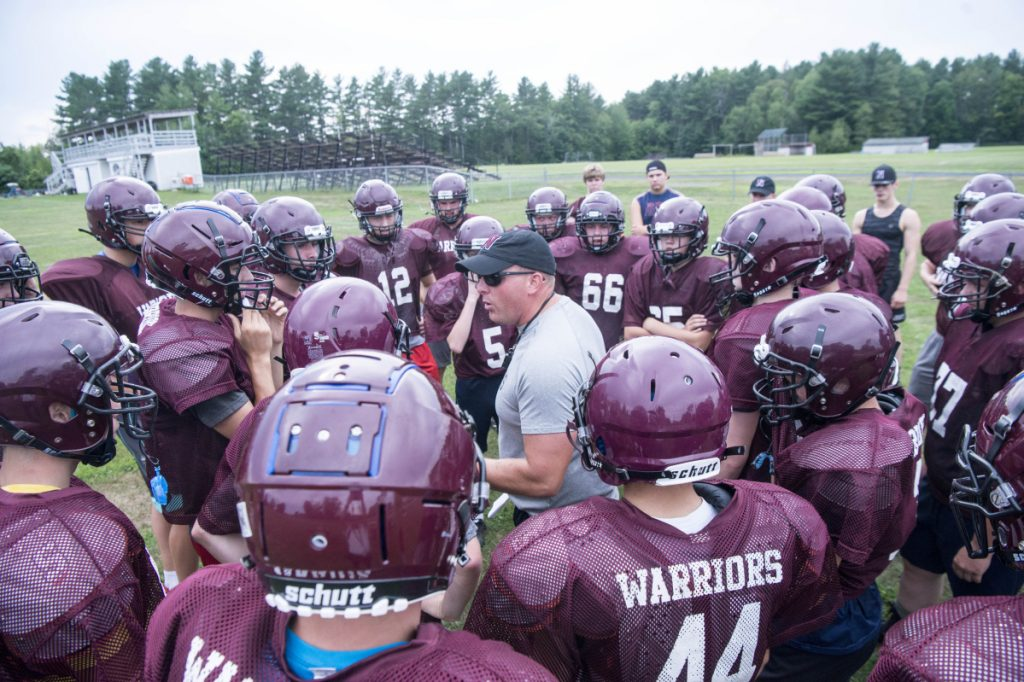 Staff photo by Michael G. Seamans   Nokomis football coach Jake Rogers talks to his team during practice Wednesday in Newport.