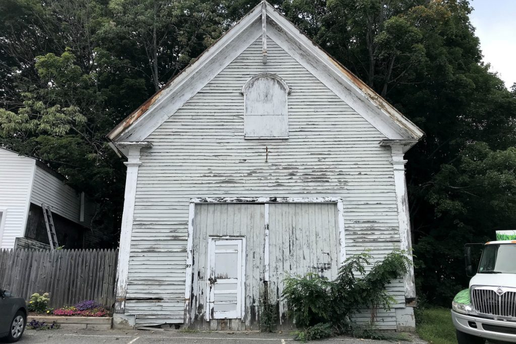 Oakland's Old School House, which dates to about 1804, is seen Friday on Church Street. The town is selling the building after the discovery of lead paint and asbestos.