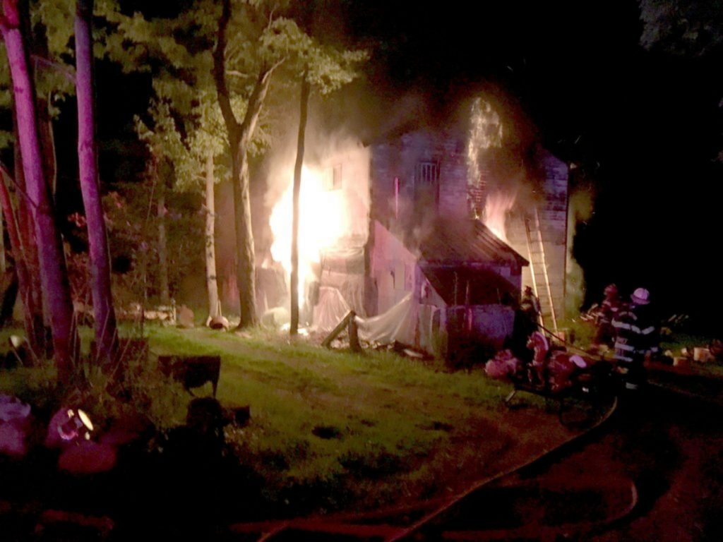 Flames engulf a home at 732 Industry Road in Farmington on Aug. 6. Angie Clark, 38, of Wilton, was arrested Friday on charges of arson and aggravated criminal mischief.