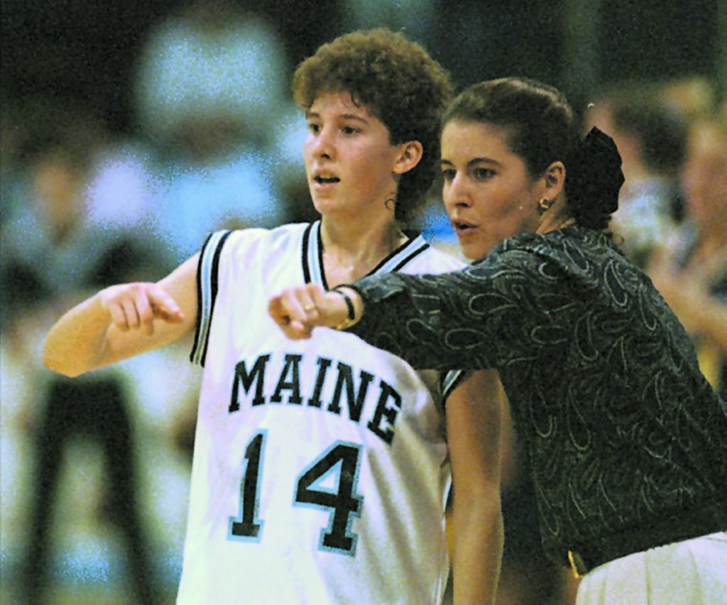 AP file photo   Maine coach Joanne Palombo goes over court strategy with Cindy Blodgett during a 1995 game against Delaware in Orono.
